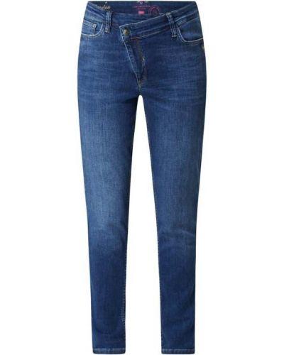 Niebieskie jeansy bawełniane asymetryczne Lieblingsstück