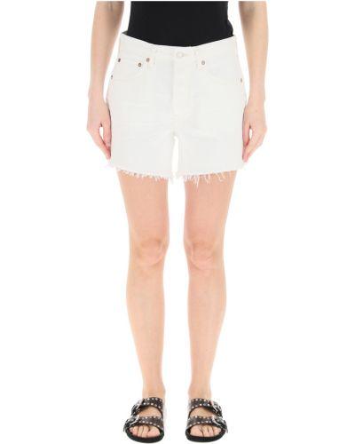 Białe jeansy Agolde