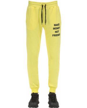 Żółte prążkowane joggery bawełniane Make Money Not Friends