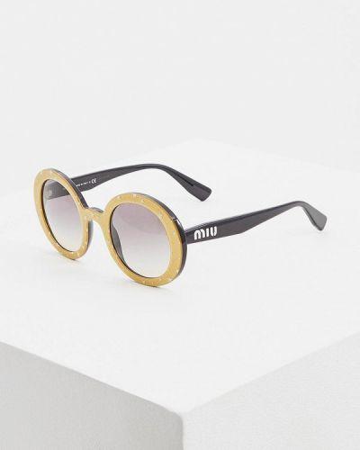 Солнцезащитные очки круглые золотой Miu Miu