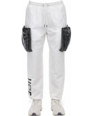 Białe spodnie ciążowe z nylonu Iise