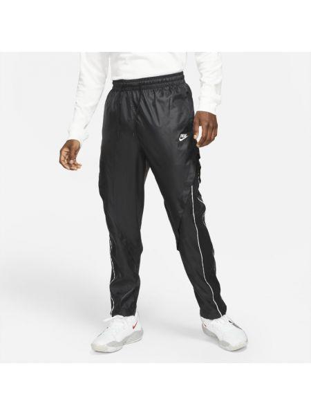 Satynowe spodnie Nike