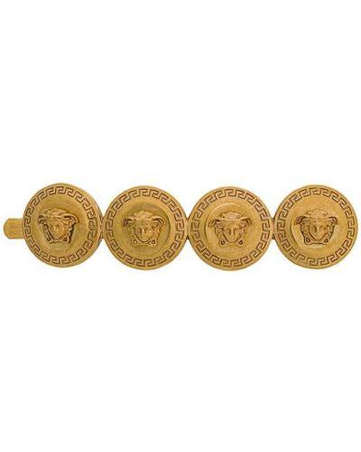Złote klipsy Versace