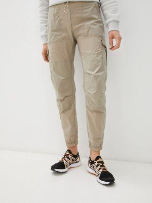 Бежевые брюки Peak Performance