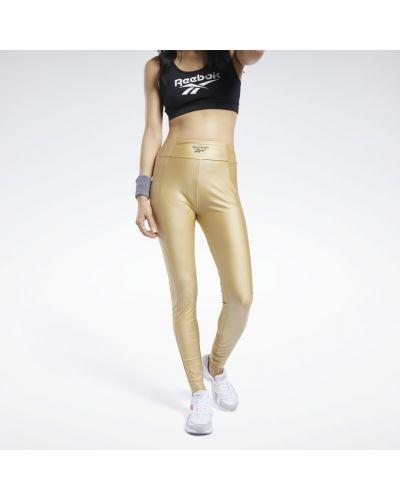 Спортивные леггинсы - золотые Reebok