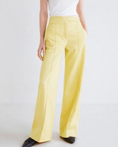 Желтые брюки Mango