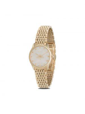Золотистые часы золотые Gucci