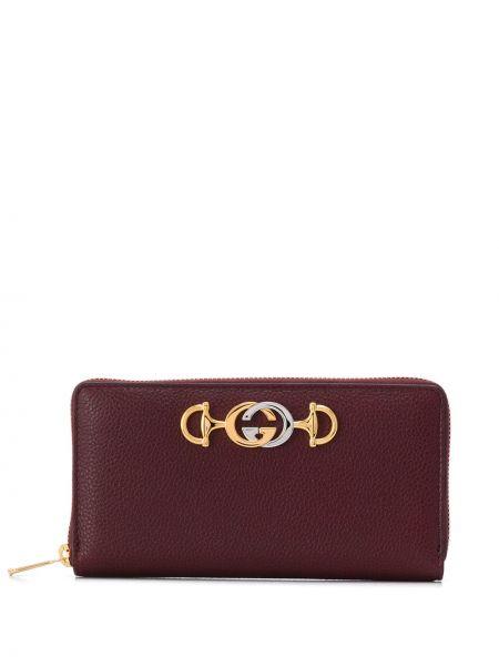 Portfel skórzany okrągły złoto Gucci
