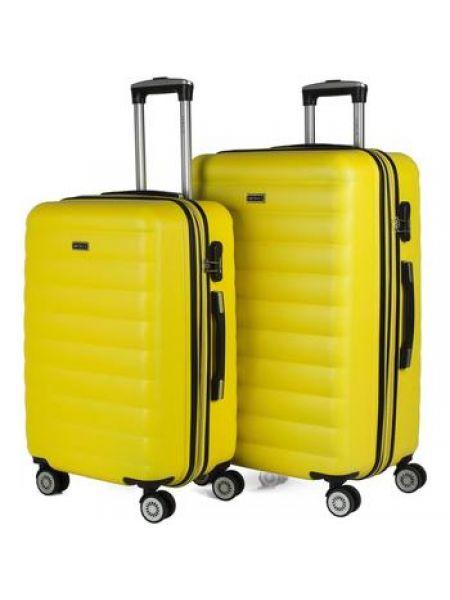 Żółty walizka przeoczenie Itaca