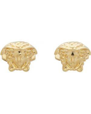Запонки узелки из золота Versace