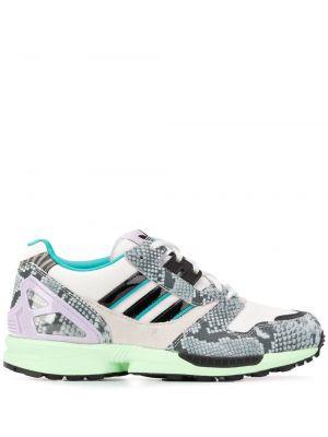 Кожаные синие кроссовки с нашивками на шнуровке Adidas