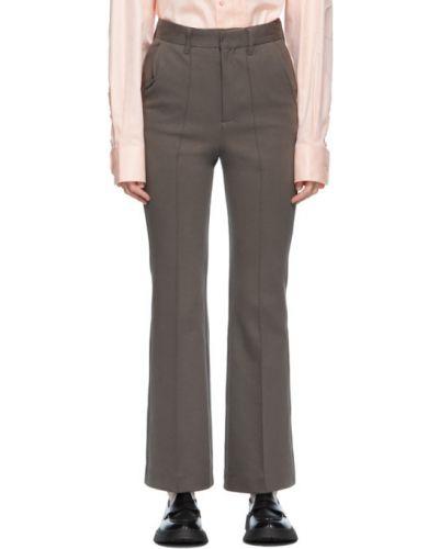 Białe spodnie bawełniane z paskiem Ader Error