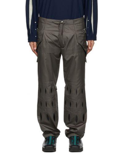 Czarne spodnie z haftem srebrne Kiko Kostadinov