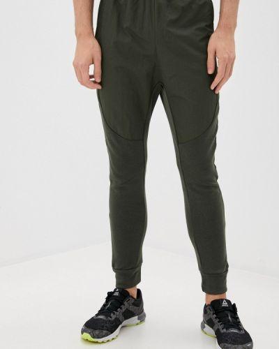 Зеленые спортивные брюки Reebok