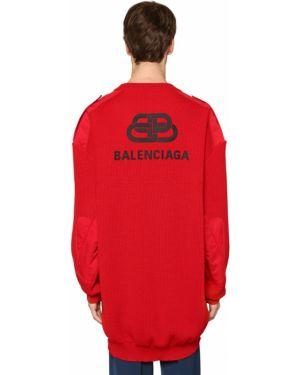 Sweter wełniany asymetryczny z haftem Balenciaga