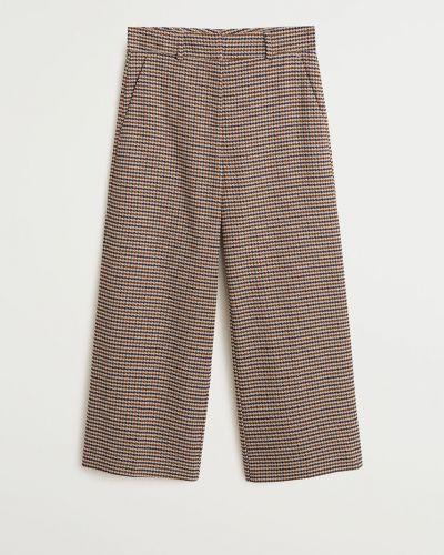 Spodnie z wzorem skromny Mango