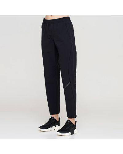 Черные спортивные брюки с карманами на молнии Anta