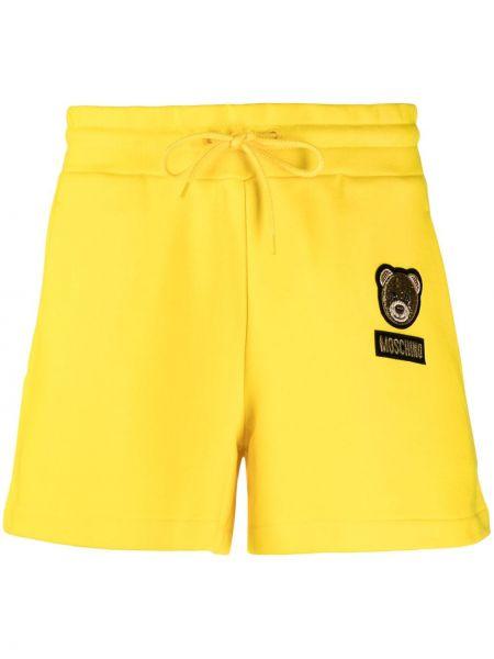 Желтые шорты с поясом с нашивками Moschino