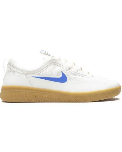 Niebieski top koronkowy sznurowany Nike