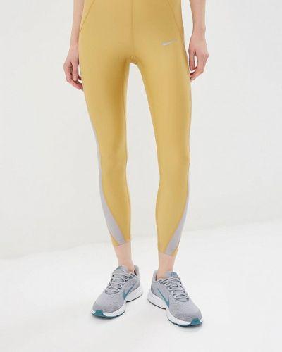 Леггинсы золотого цвета Nike