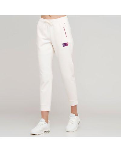 Белые спортивные брюки с поясом Anta