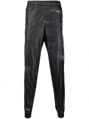 Czarne spodnie z printem Cottweiler