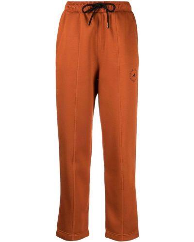 Pomarańczowe spodnie Adidas By Stella Mccartney