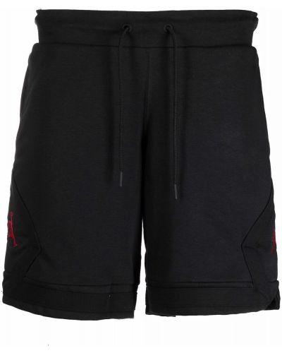 Хлопковые черные спортивные шорты Nike