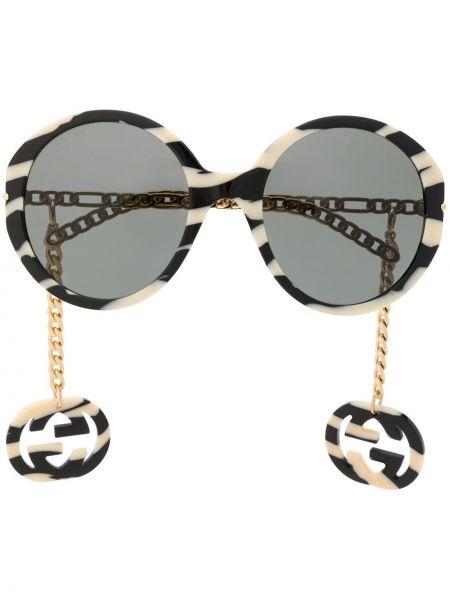 Złote czarne okulary z printem Gucci Eyewear