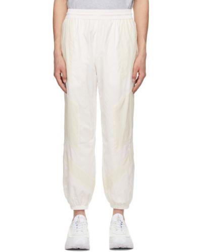 Белые брюки сетчатые с манжетами Mcq
