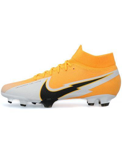 Кожаные оранжевые футбольные бутсы Nike