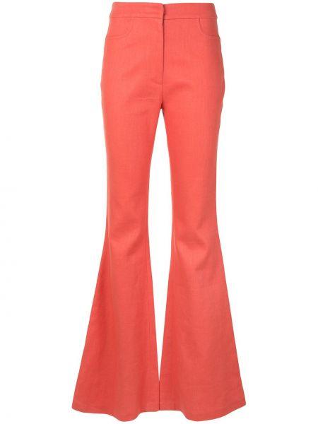 Расклешенные розовые брюки с карманами узкого кроя Alexis