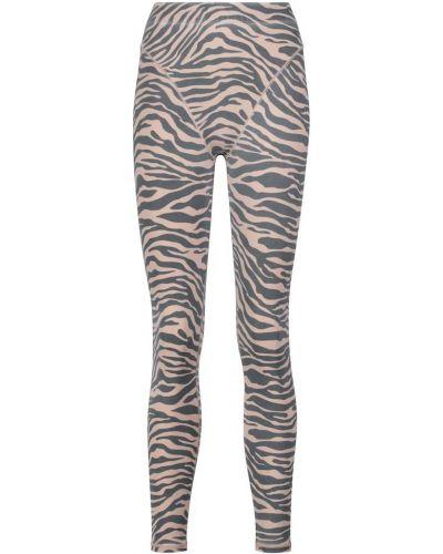 Beżowe spodnie z printem Adam Selman Sport
