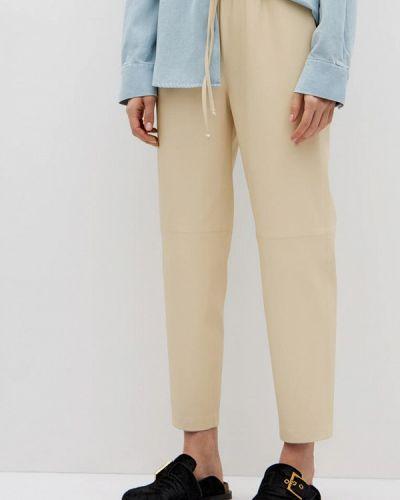 Кожаные бежевые брюки Lime
