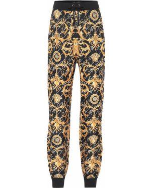 Спортивные брюки золотой шелковые Versace