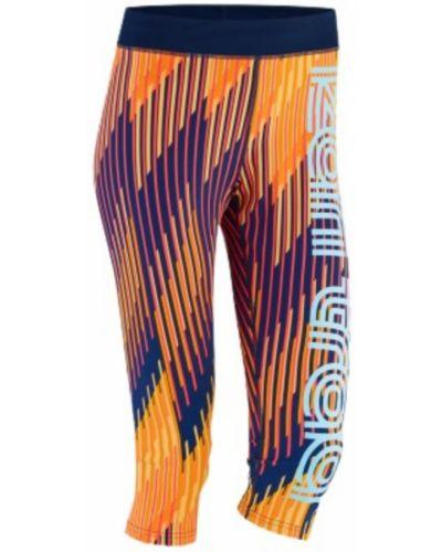 Pomarańczowe legginsy sportowe w paski oversize Kari Traa