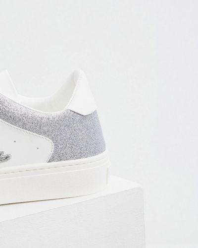 Кожаные белые низкие кеды Furla