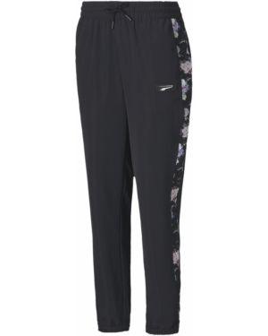 Спортивные брюки в цветочный принт с поясом Puma