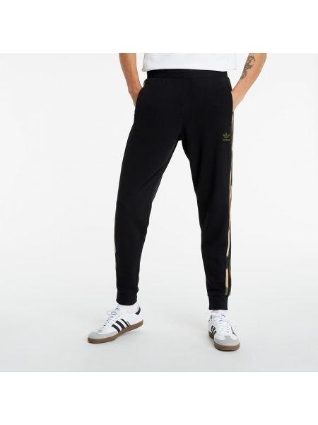 Czarne joggery w paski Adidas Originals