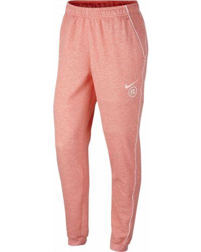 Różowe spodnie casual Nike