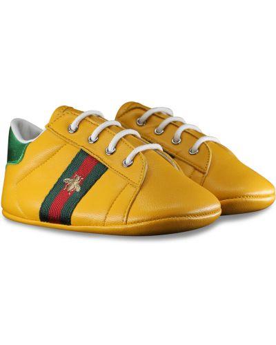 Żółte trampki Gucci