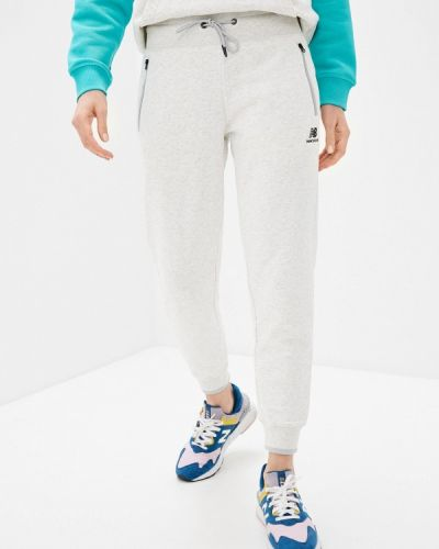 Серые спортивные брюки New Balance