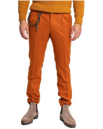 Pomarańczowe spodnie Berwich