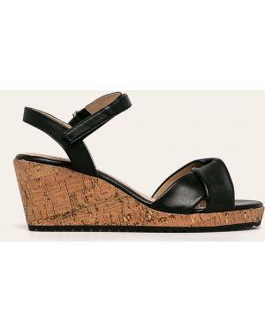 Sandały na koturnie skórzany rzep Caprice