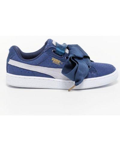 Satynowe niebieskie jeansy eleganckie Puma