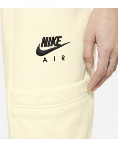 Spodnie dzianinowe z haftem na co dzień Nike