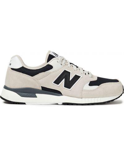 Бежевые кожаные кроссовки на шнурках New Balance