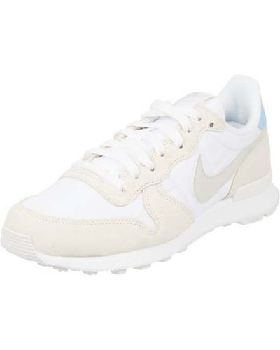 Białe sneakersy skorzane Nike