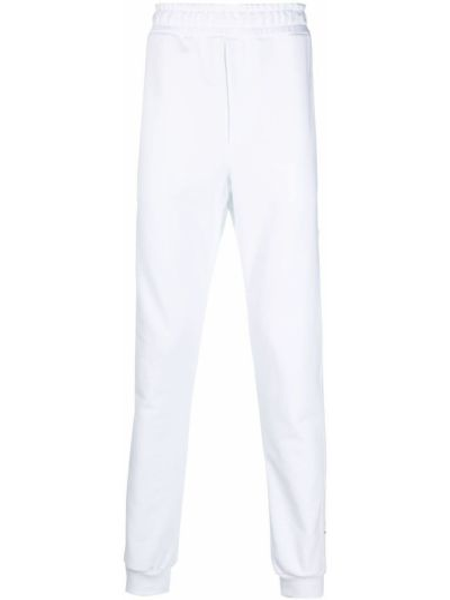 Białe spodnie bawełniane z printem Omc