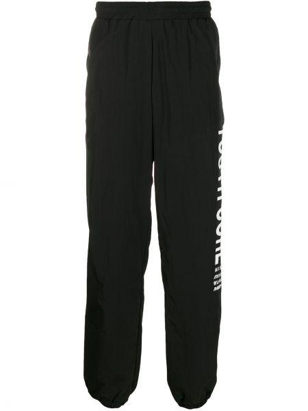 Czarne spodnie z wysokim stanem z wiskozy Misbhv